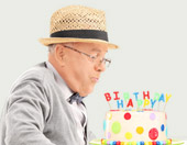 older man with birthday cake